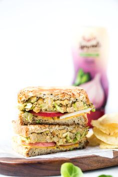 This is hands down THE BEST vegan grilled cheese ever! with brussels sprouts, hummus, apples and more!