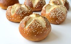These delightful pretzle buns are poached in hot water and baking soda before being baked so they have a crusty brown exterior but they're soft and doughy inside. They're perfect for making sandwiches or you can have them accompany your main course.