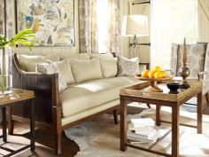 Leather embellishments and studded edges add a rustic feel to this sofa but keeps the contemporary design elements with the neutral beige fabric  http://lamaisonaz.com/blog/contemporary-sofa-selection