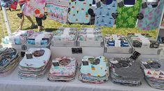 The new 'just in case high winds' display! One table has 6 piles of baby bibs at…