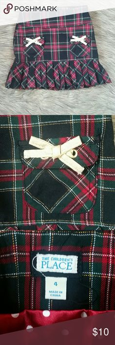 Children's Place Plaid Mini Skirt Sz4 NWOT Red/green/white plaid with gold metallic bows Polka dot lining/ side zipper  65% polyester / 34% rayon / 1% other fiber Children's Place Dresses