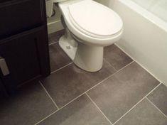 $1.08 sq ft TrafficMASTER Ceramica 12 in. x 24 in. Coastal Grey Resilient Vinyl Tile Flooring (30 sq. ft. / case)-24716C - The Home Depot