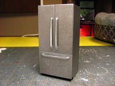This is the refrigerator I made for the corner cabinet dollhouse.  I made the original from bass wood, this one is made from mat bo...