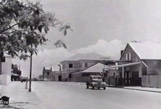 Bennett Street looking toward Smith Street, Bank of New South Wales and Commercial Bank far right Commonwealth Bank far left with Jollys store opposite in the distance 1940 Commonwealth Bank, Commercial Bank, Darwin, South Wales, Distance, Australia, History, Street, Outdoor