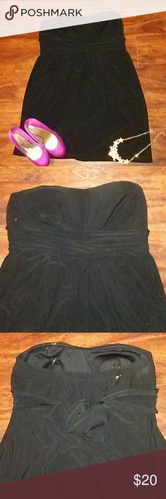 Perfect LBD This gorgeous fitted little black dress is perfect. Made if 100% polyester it has deep pockets in the front and ties in the back. The spandex gives is some room, stops above the knee. Wishes  Dresses Mini