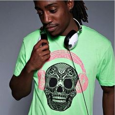 Electro Skull = 10pts of bad ass!! Get your now on ⭐️www.ElectroThreads.com⭐️ #neon #electroskull #headphones #glowsinthedark #blacklight #clothes #edm #music