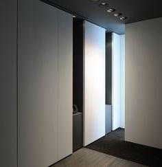Minimalist interior and sleek lighting at the Kreon show-room, Parijs _ by architect Minus _