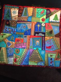Christmas Crazy Quilt.  Designs from Molly Mine series 1. Made into wall hanging for Christmas 2011