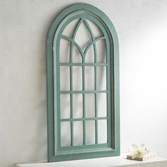 Hanging an arched window is tricky stuff. Hanging our window-like arch? Pretty simple. More of an architectural element than a simple wall hanging, its rustic wooden frame is worthy of a Mediterranean villa.