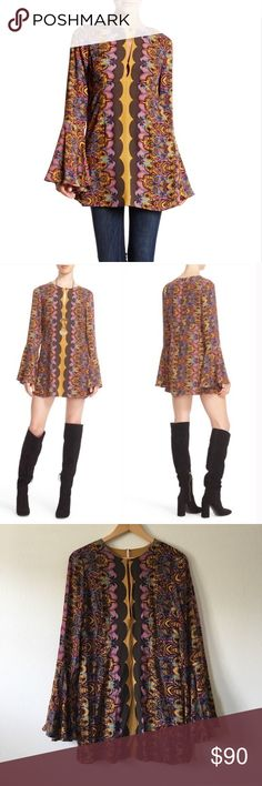 Free People Ossie Vibes Tunic Free People 'Ossie Vibes' Bell Sleeve Tunic Graphic printed woven shift dress. Long bell sleeves. Keyhole neckline with button and hook and eye closures. Side zipper closure. Unlined. Free People Tops Tunics