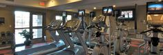 Plug in your headphones and watch TV  while you work out at your FITNESS CENTER | The Pavilion on Berry Saint Paul, Minnesota