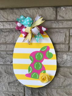 This Easter egg door hanger with bunny is made of wood. We work hard to bring you never seen before designs! This 2018 design will have your door the best dressed this easter! We can custom colors Depending on stock ribbons may vary, but will still be super cute.