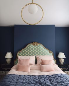 These Stiffkey Blue walls add the perfect backdrop to the vintage furnishings in Megan Ellaby's beautiful bedroom