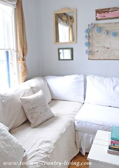 Add a washed drop cloth to your sofa for a linen looking slipcover.