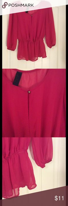 Fuschia peplum blouse Gold button closure. Elastic around waist and sleeves for a flattering fit. Francesca's Collections Tops