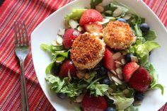 Fried goat cheese salad with mixed baby greens and berries