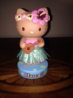 Hello Kitty Bobble Head Bobble Body Pink and Yellow Floral Head Wreath Pink Hibiscus Grass Skirt Pink Swim Top Ukulele Hula Girl