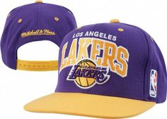 Help support your favorite team in this NBA Team Arch Retro Snap Back Hat from Mitchell & Ness. Features embroidered logo's, stylish adjustable snap back, and contrasting team colors for added style. Made of 100% wool and officially licensed by the NBA.