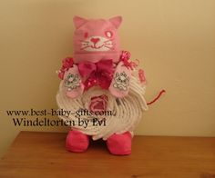 diaper cat / cat diaper cake for baby girl: contains a very cute cat hat (Esprit) and some cat baby socks (H&M); cute baby shower decoration