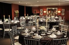 Candles and chocolate tablecloths make an elegant wedding reception table setting at Lorien Hotel & Spa. {Lorien Hotel & Spa}