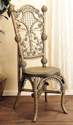 Lady's Reception Wicker Chair Befitting fashionable ladies of the Victorian era, this reception chair no longer requires a calling card for everyday enjoyment. Exquisite in every detail, it features swirls and tight scrolls framing open lattice at the back with swirled ball castings as accents. Cabriole legs offer a tight weave with arching supports and a daisy chain of circles adding their delicate adornments.