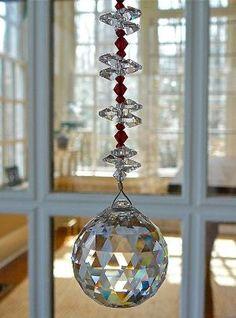I think I could make this. Swarovski Crystal Sun Catcher by jami