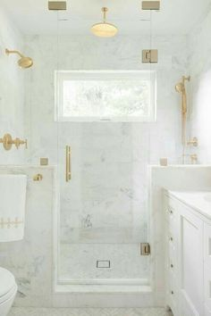 Bathroom inspo. Note brass hardware coupled with White and grey marble/ceramic tiles