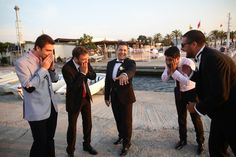 "The groomsmen do ""The Ring"" pose! :D"