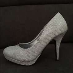 Silver Heels Really cute silver heels, they have only been worn twice. The heel is about 4 inches Shoes Heels