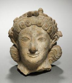 Head of Artemis, 600-575 BC Greece, late 6th Century BC  terracotta