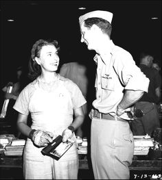 Major Robert K. Morgan, pilot of the B-17 bomber Memphis Belle (named after his Tennessee girlfriend) chats with plant worker Virginia Johnson at BMI on July 13, 1943. Magnesium ingots are visible behind them on tables and conveyors. See our Magnesium Maggie board for more photos of BMI's dedicated women: http://www.pinterest.com/mypublib/magnesium-maggie-world-war-ii-women-of-industry-in/