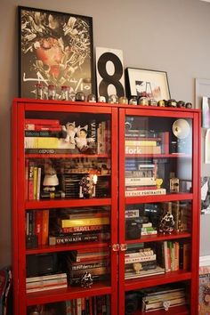 love this bookshelf.. and especially the #davidchoe print on top of it