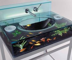 Fish Aquarium Sink. Fish are even more useless than birds as pets, but again...this is pretty sweet.