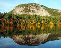 Gorgeous reflection of turning foliage in the New Hampshire Lakes Region - www.lakesregion.org