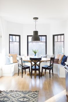 How to Design a Beautiful Kitchen Banquette modern farmhouse black dining room chairs oval wood pedestal table IKEA Hektar black pendant black windows oval pedestal farmhouse table