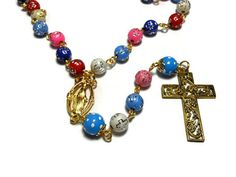 Use code SOCIAL15 for 15% off all purchases over $15, plus FREE shipping on most jewelry! Cross beads rosary 'Joyful colors' acrylic cross beads, upcycled hand painted polka dot Our Fathers, gold crucifix and Virgin Mary medal.   The colorful 10mm blue pink red ... #etsygifts #vintage #vjse2 #jewelry #gift