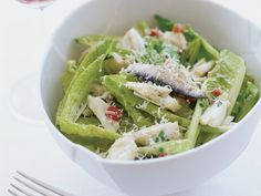 Crab Salad with Caesar Vinaigrette | Chef Way At Custom House, the salty and piquant anchovy- and-Parmesan dressing for this salad gets pounded by hand in a mortar with a pestle, then tos...