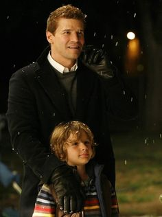 Parker and Booth giving Bones the best Christmas present