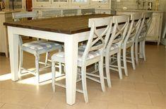 Lankkupöytä, esim.230x110 cm. Pöydän kansi pintakäsitelty tummaksi, jaloissa vaaleanharmaa maali.