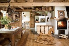 I like this kitchen because it does feel more like a cosy sitting room. It had nice angles and.... a big fireplace.