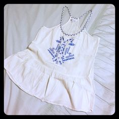 Boho tank Adorable boho tank is perfect for a day at the beach. Blue stitched pattern on the front completes a unique look. The flowy top keeps you cool while you're looking good! Charming Charlie Tops Tank Tops