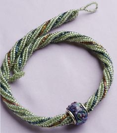 Doris Coghill's Fresh Twist beaded necklace shows off many colorful beads by using tubular herringbone stitch and flat peyote stitch.