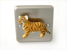 Brushed Chrome Safari Tiger Cub Light Switch by Candy Queen Designs A safari animal themed Light Switch with a real twist! Why buy a light switch cover when you can exchange the whole light switch for one which will quite simply demand attention by all who enter the room.