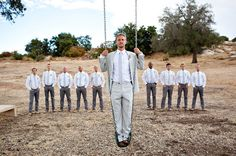 The groomsmen will have slightly darker gray colored tuxes.. and bow ties of course ;]