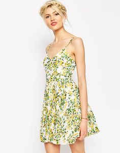 Image 1 ofASOS Sheer And Solid Pleated Mini Dress in Yellow Floral