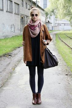 Loosely fitted mini with a simple jacket and scarf layered on top. The short boots and mini dress elongate the legs in a flattering way.