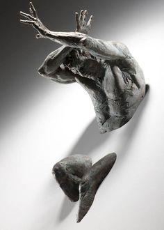 Bronze Sculptures Emerge from Walls