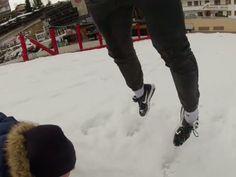 Sledding under my friend . it was so much fun