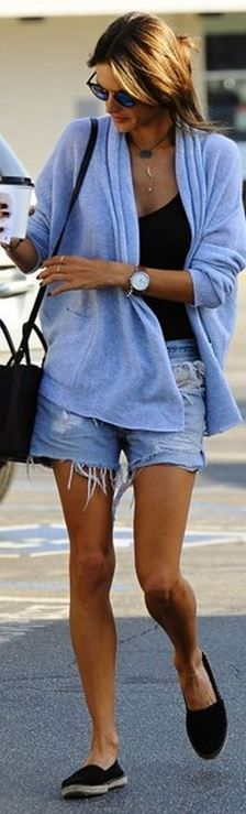 Who made  Alessandra Ambrosio's black handbag, blue cut off shorts, blue cardigan sweater, and sunglasses?