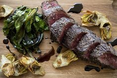 Wagyu beef culotte with black currant sauce, wilted greens and garlic-glazed artichokes.